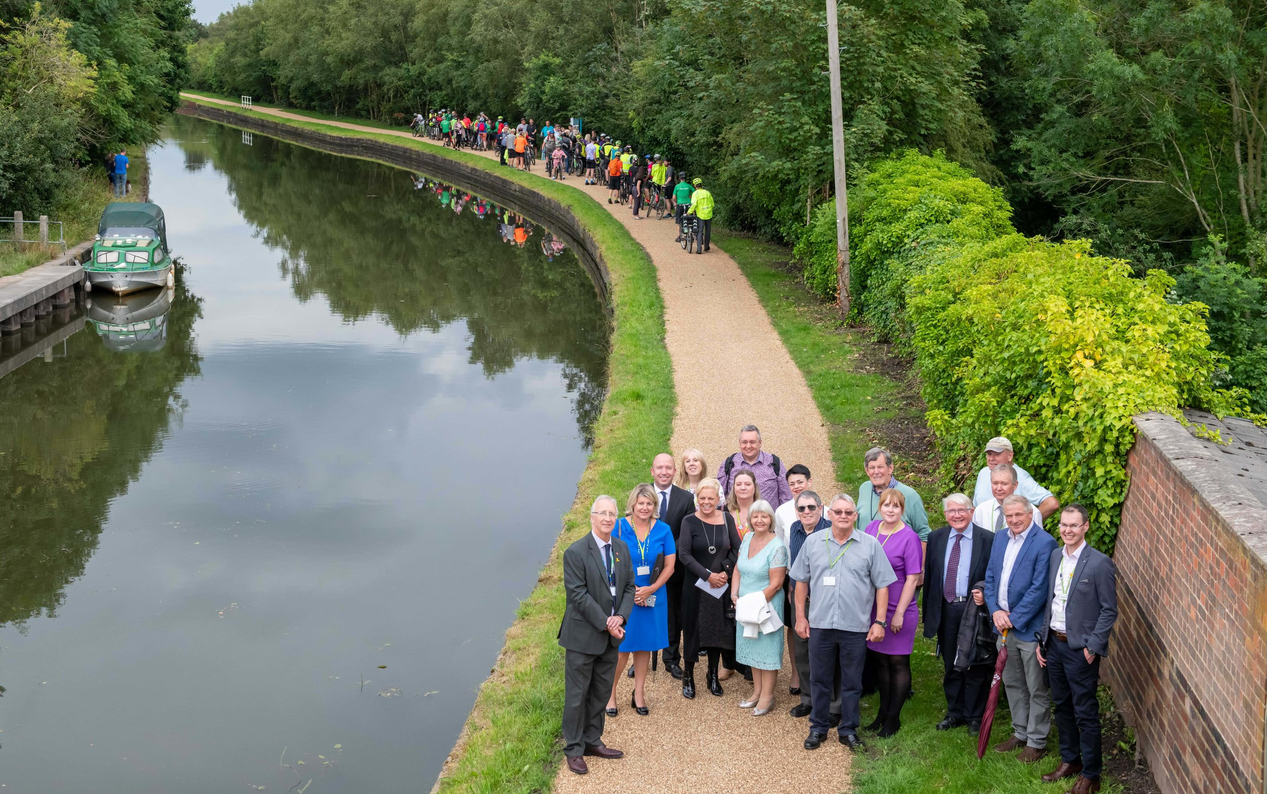 Members of the public, Wigan Council, TfGM and Peel L&P gathered to celebrate.jpg