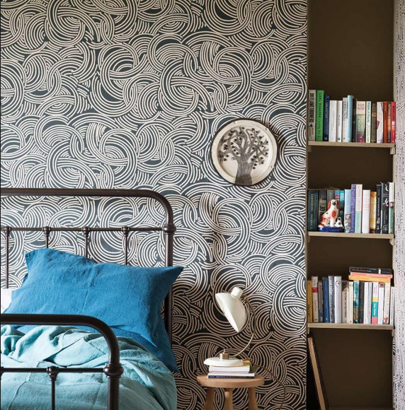 We also fell for Farrow & Ball's Tourbillon wallpaper which we used in the niche of the  Atelier to create a dramatic backdrop.