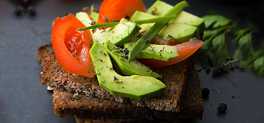 100% Whole Grain German Rye Toast Recipe! This versatile bread is a staple in my kitchen. It's probably the healthiest bread around, with a lot of protein and iron. Toast it and serve with olive oil, sliced tomato, avocado, sea salt - Sweet Science Nutrition & Wellness, Healthy Sobriety with health coach Elena Skroznikova