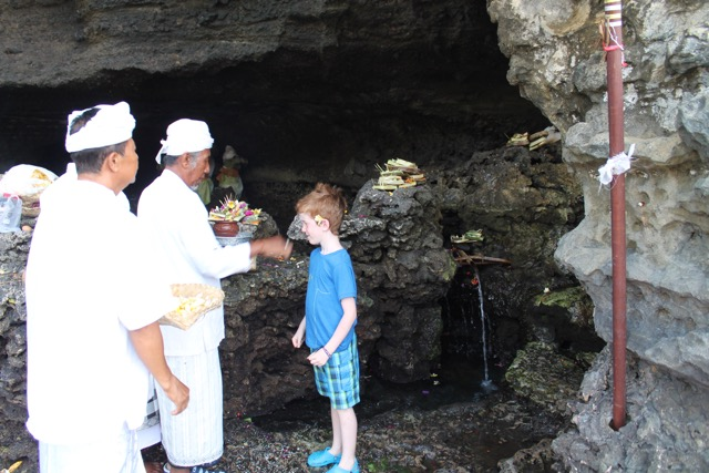 Washing and being blessed by Holy water from the Tanah Lot temple.