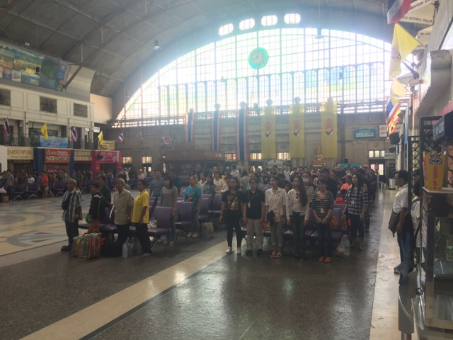 At the train station.  At 8am, everyone stands for the national anthem