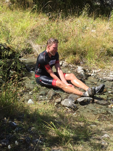 Cooling down in an ice cold mountain stream.
