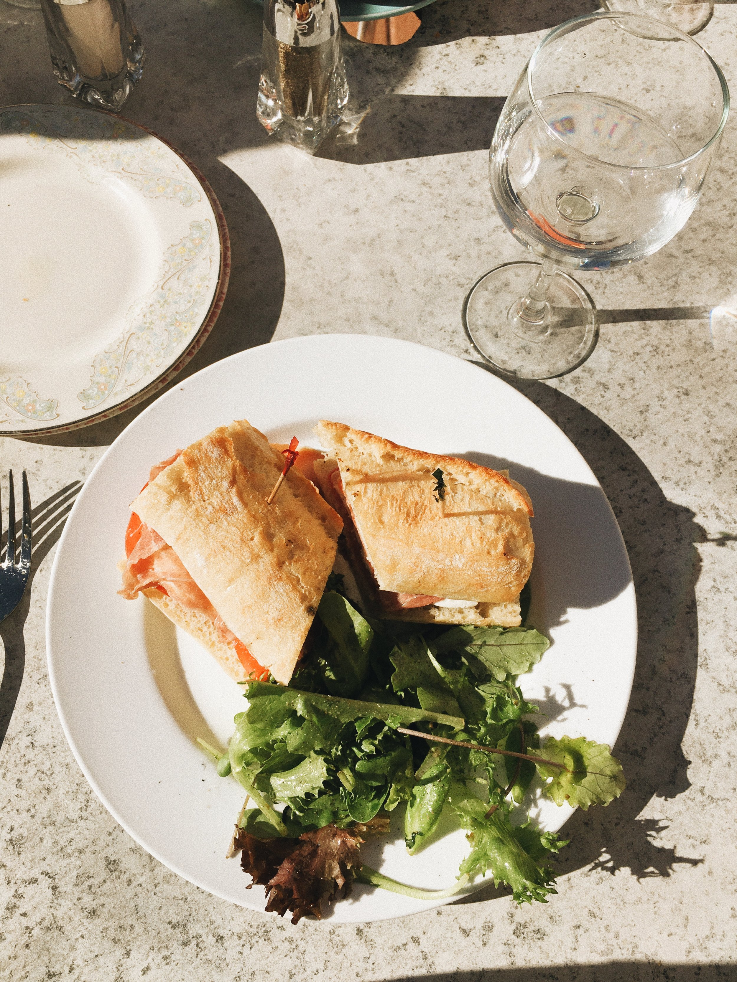 along 5th ave is a place called Bellini. I was walking through the streets as a local art show was going on and sat down for a bite of lunch. the fresh simple salads were delicious and the special was this prosciutto sandwich, the bestttt!