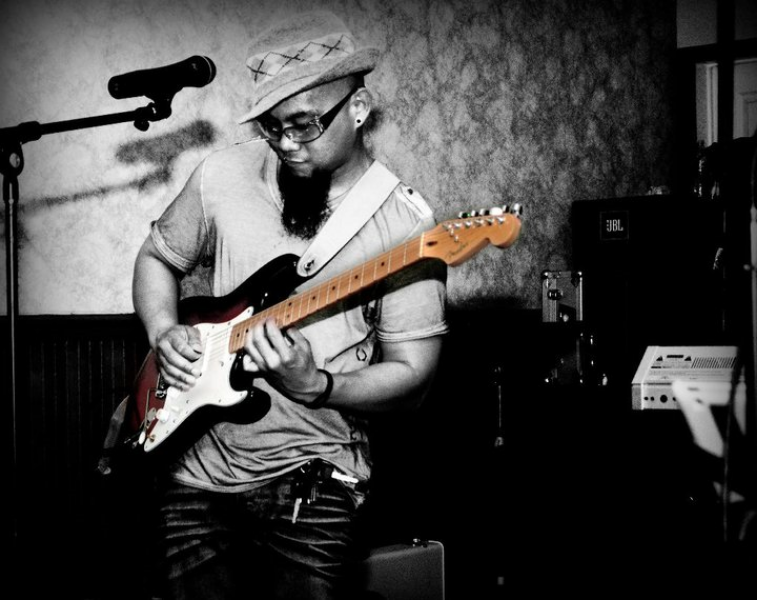 "Carlo is a self taught guitarist and bassist who came from a very musical family. His musical influences are his father and uncle (C2 Musical Director) as well as notable musicians such as Bob Marley, Slash, Tuck amaze, Carlos Santana etc. Carlo's musical influences apply to him in many ways and when he is on stage he lets the music take over and just goes with the flow. Carlo is a seasoned performer and considers being in Chapter 2 a personal success. Carlo considers being in Chapter 2 a personal success. He credits his uncle, Chapter2's Musical Director Noel Tampac, for nurturing his talent and giving him the opportunity to be in the band. ""I never thought I'd be able to do a lot of what I'm doing right now, music-wise if it wasn't for him...he believes in me."""