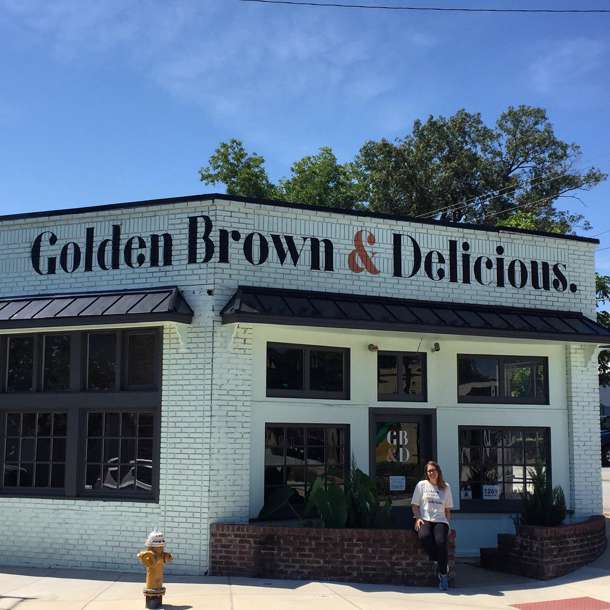 Hand painted logo on the exterior of Golden Brown & Delicious, in the Village of West Greenville. Logo design by Michael Asire. Completed in July 2017.