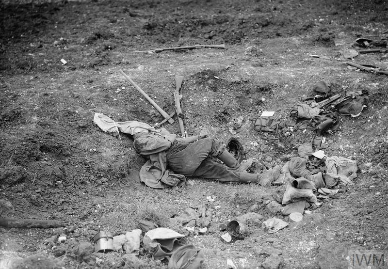 A German soldier, his face covered, dead on the battlefield near Beaumont Hamel, July 1916.