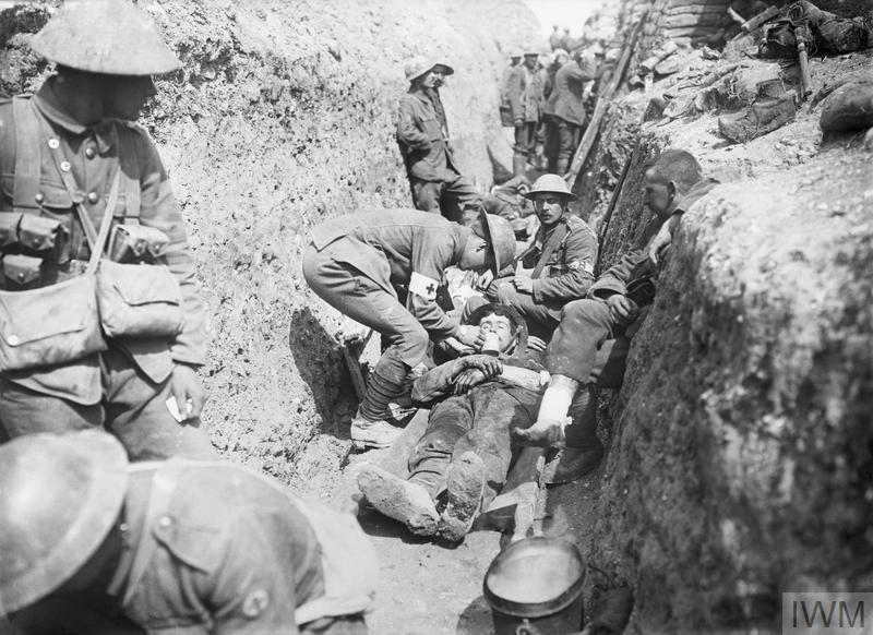 Wounded men of the 1st Battalion, Lancashire Fusiliers, being tended in a trench in the 29th Division's area near Beaumont Hamel on the morning of the initial assault, 1st July 1916.
