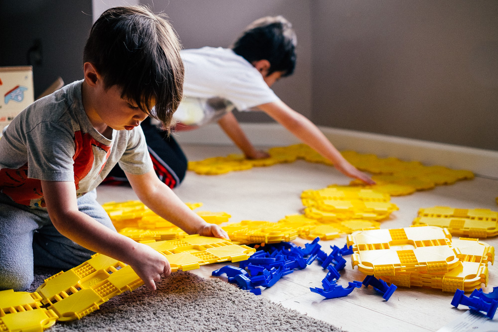Kids at play with Fort Boards fort building kits, an imaginative educational toy
