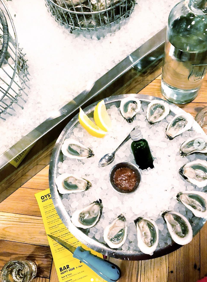 Divine Pine oysters from North Carolina plated at Watchman's Seafood & Spirits in Atlanta. Photo: jessgraves.com