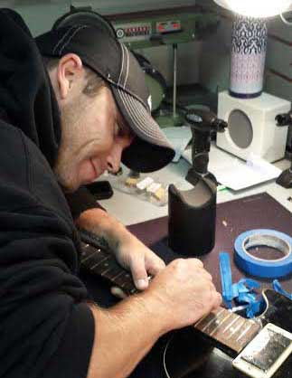 In-house technician, travis fuller, working on a repair
