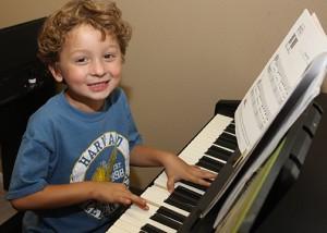 boy enjoying recreation music lesson with houston piano company.jpg
