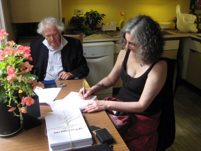Signing the contract with Peter Knight, of Knight Features Literary Agency, London, England. Not pictured but nearby, Liberty's lovely agent, Samantha Ferris, who handles their non-fiction books.