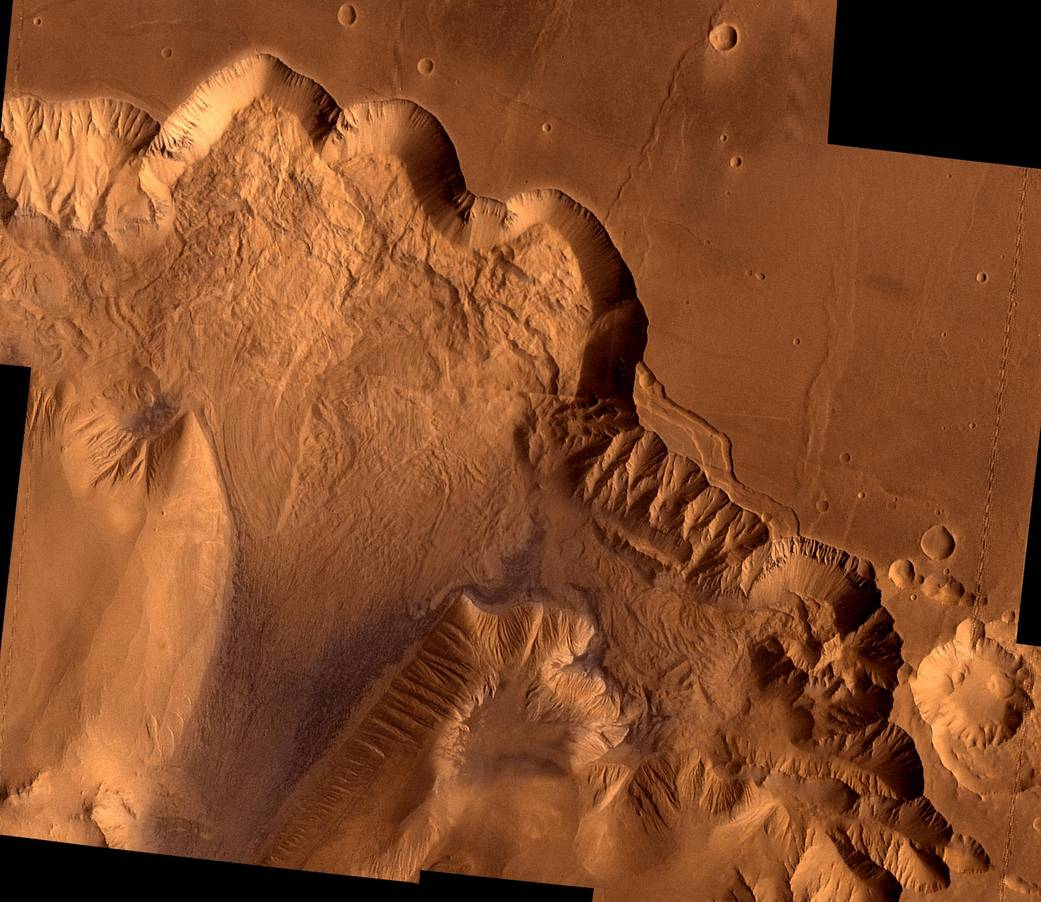 Dr. Jessica Watkins  talks about enormous landslides on Mars that are millions of years old. This image is of Ophir Chasma, on the surface of Mars. Image Credit: NASA/JPL/USGS