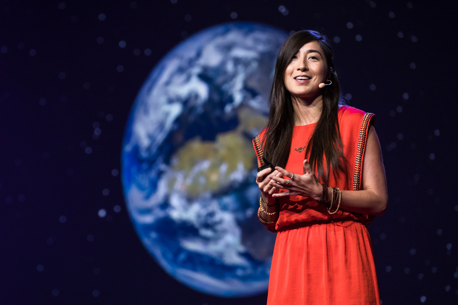 """Dr. Miho Janvier  talks about her work studying solar storms, and tells us about the ways these storms have impacted humans in the past. She explains why they are challenging to model and says why she's interested in """"garbage"""" data from planetary missions.  Folllow Dr. Janvier on  Twitter , and watch her  TED talk !   Image : Miho Janvier speaks at TEDGlobal 2017, Arusha, Tanzania. Photo: Ryan Lash / TED"""