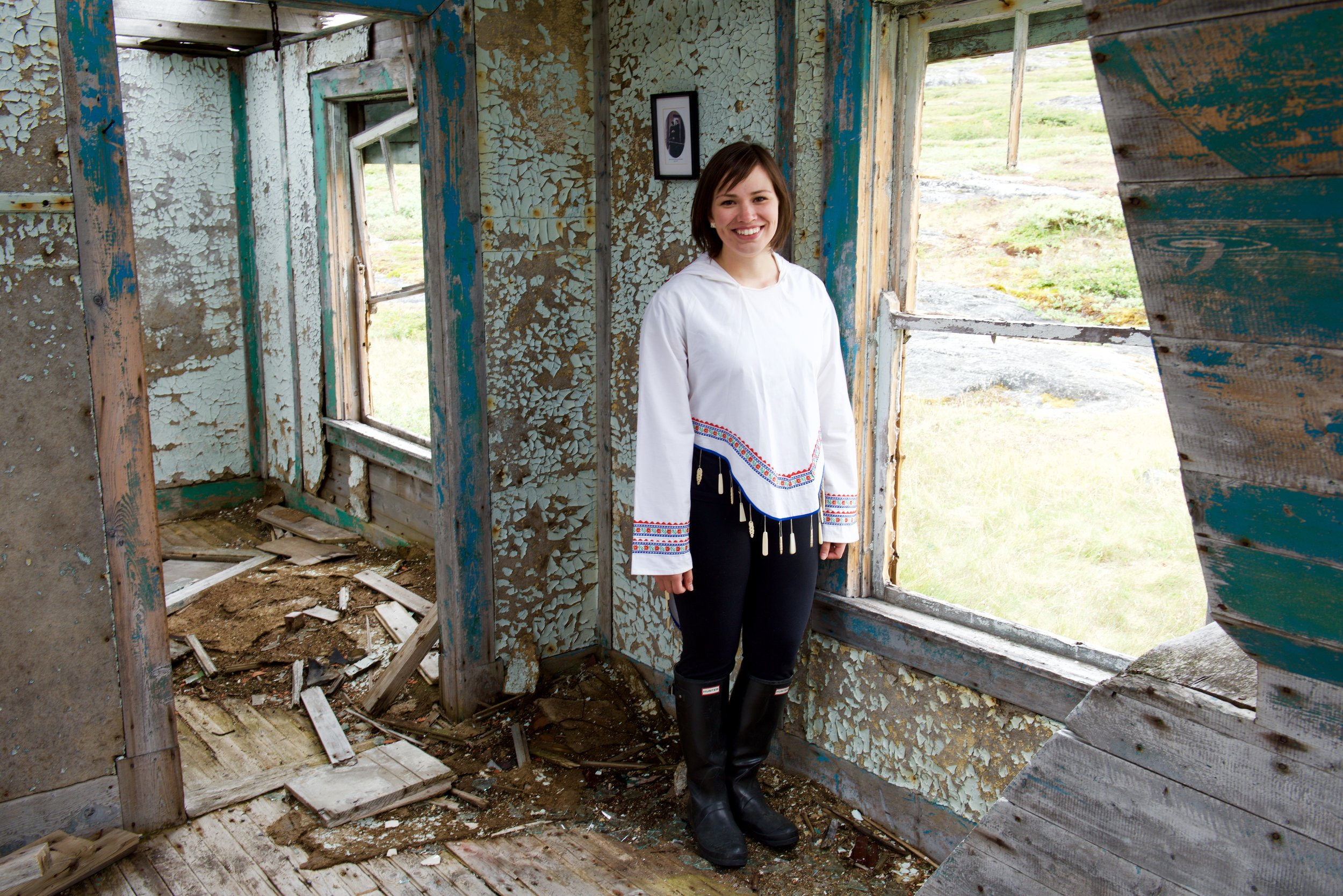 Caitlyn Baikie, from Nain, stands in her great-grandmothers house in Hebron, Nunatsiavut.