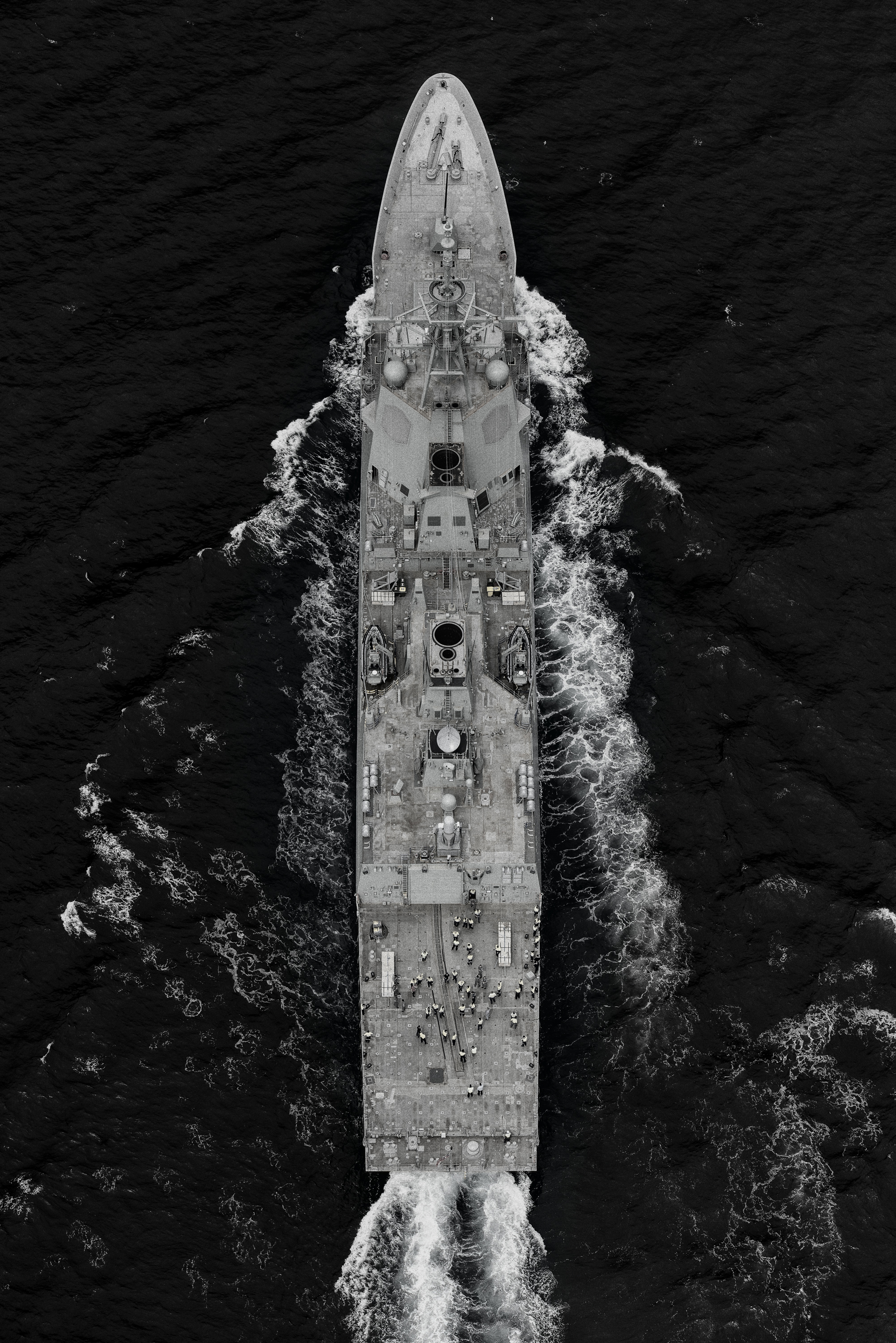 NUSHIP Brisbane (III) is the second of three ships of the Hobart Class guided missile destroyers. This image was captured for the  Air Warfare Destroyer Alliance  from a helicopter as she underwent sea trials in the Gulf St Vincent. You can see that her deck is yet to be prepared for final delivery. It was a great experience directing a very large ship to undertake specific manoeuvres for the camera - the skipper was amazing, it was an incredible sight to see just how nimble a ship of this size can be! Upon commissioning into the Royal Australian Navy fleet she becomes known as HMAS Brisbane. Shot on a Nikon D800 and processed in Lightroom, Photoshop and Nik Silver Efex.