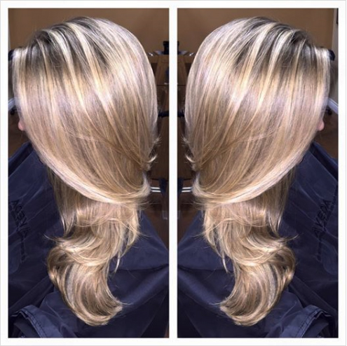 We can't get enough of this perfect blonde!  The depth at the root allows the blonde highlights to pop! A color gloss adds intense shine and helps keep brassiness at bay. Color, cut & style by Brittany H. at our Summerlin location.