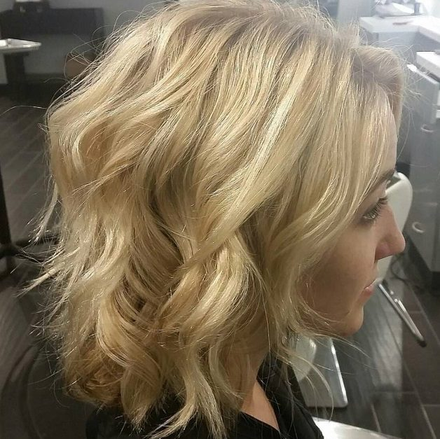 Hello Gorgeous! We love this beautiful wavy bob by Rita at our Southern Hills location.