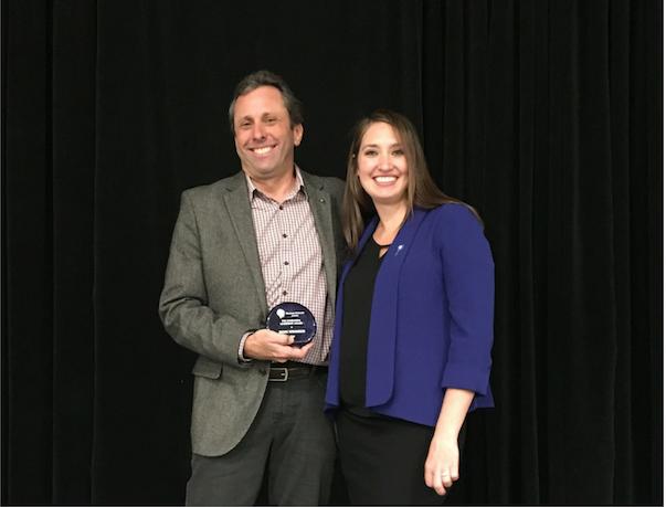 Awardee Marc Winokur, and Illuminate Colorado Executive Director Jade Woodard