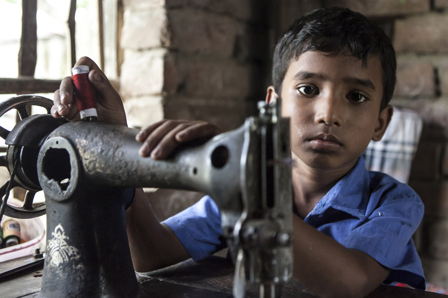 child in bangladesh sewing.jpg