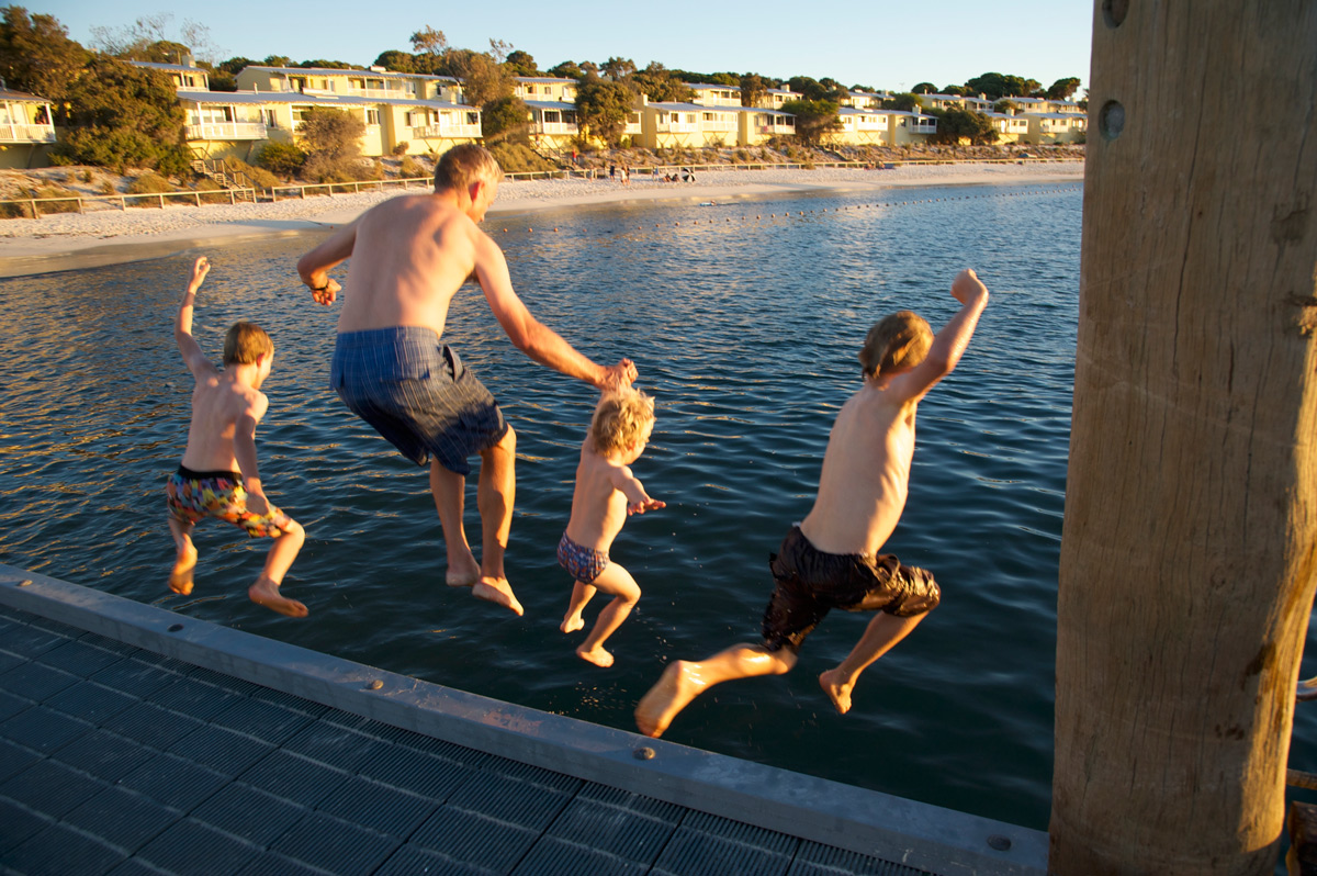 family-jumping-off-the-jetty.jpg