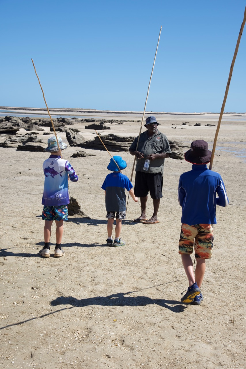 Spear making with kids at beach