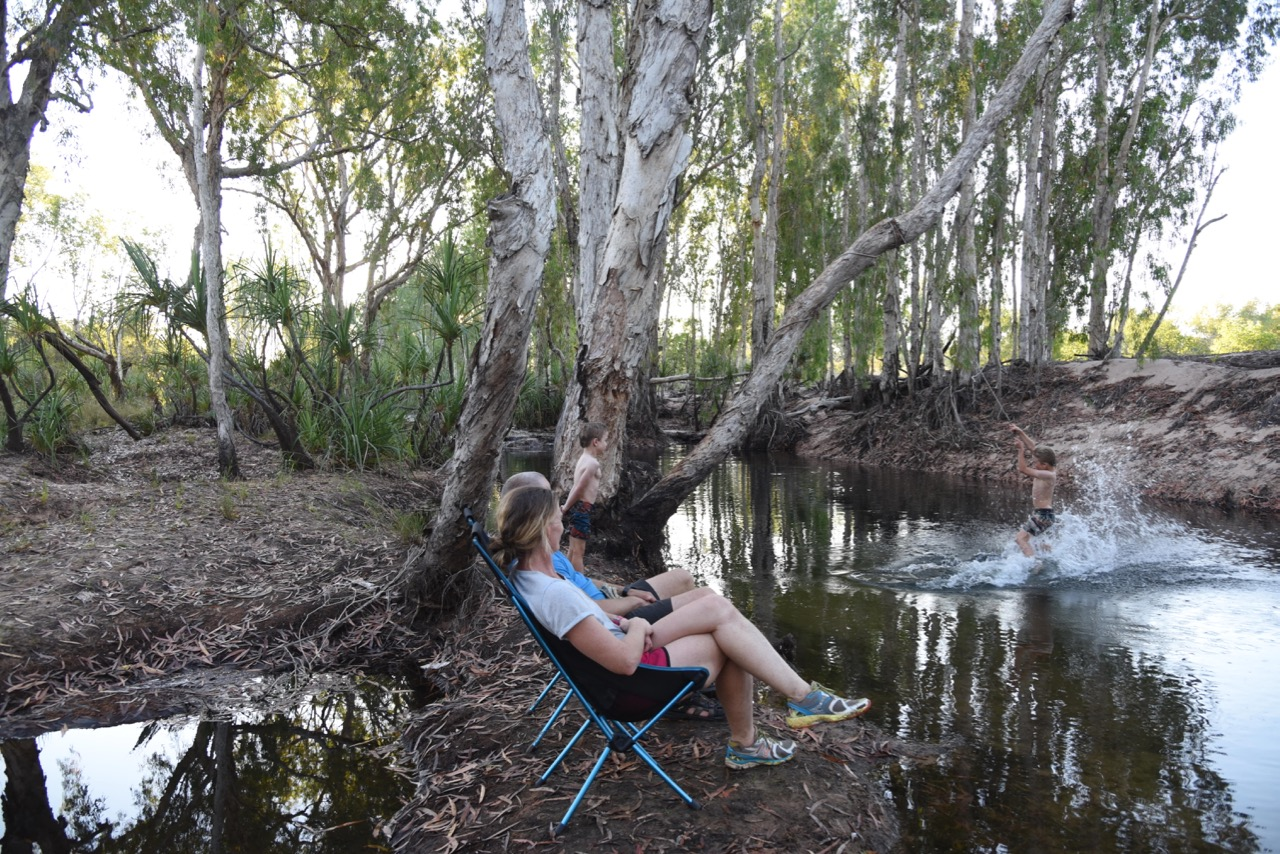 Rope swing with kids on river