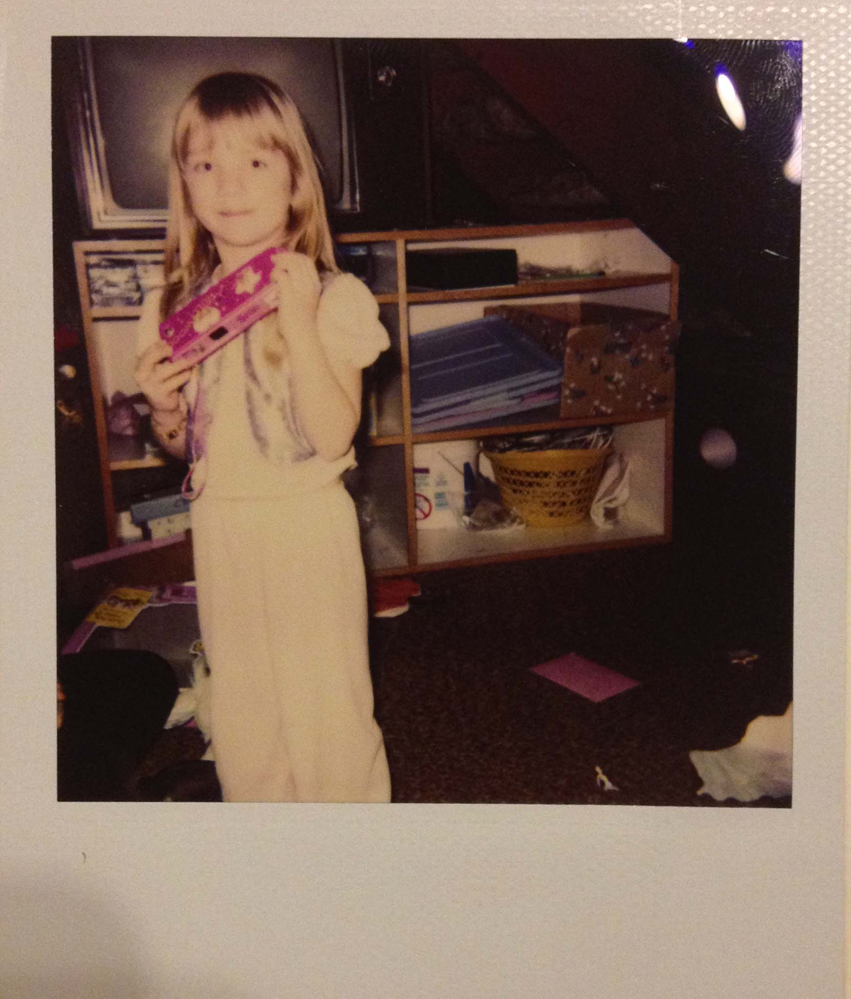 My first camera, a 110mm film camera (and rocking Aladdin pjs)