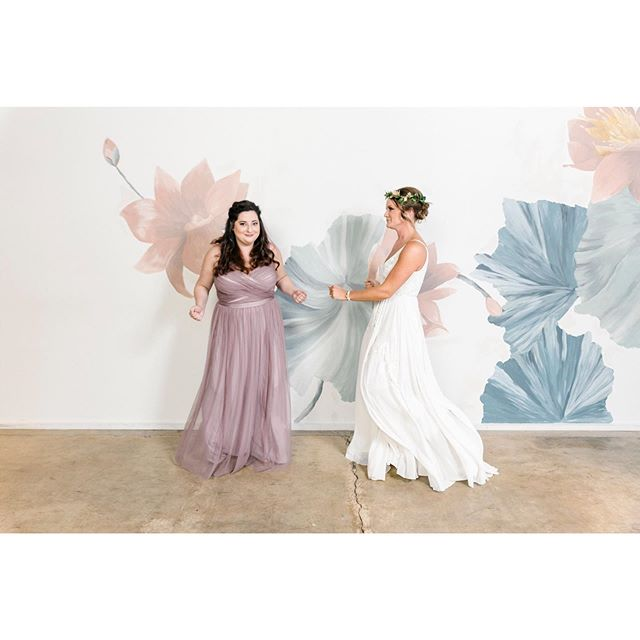 Ba de ya - dancing in September! Why not dance towards your bridesmaid for your bridal party photos?! Loved these two's energy! And their bridal party dresses matched the tones of @wildcarrot.stl walls perfectly! Swipe ⬅️ to see more of these amazing, gorgeous ladies! • • • • • • #septemberwedding #dancing #laughter #amazingladies #squadgoals #bride #bridesmaids #thesetones #dancinginseptember #bridalparty #bridalpartyphotos #weddingphotography #weddingphotographer #stlwedding #stlweddingphotographer #rebeccakclarkphotography #realwedding
