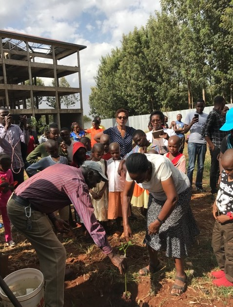 In February, the Nyeri County Government donated 100 avocado trees to the Vocational Training Center to be used to generate income for the Center and help feed the children in the nearby Tumaini and Huruma Children's homes. Photo:Mrs. Eunice Muindi plants the first tree with children and alumni from the homes.