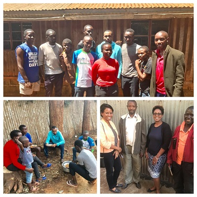 Alumni and Tumaini children help clean the bakery space to prepare for construction.