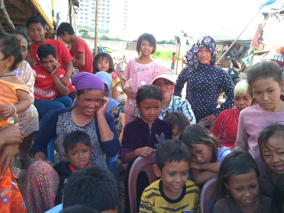 Children and families listen to our health staff about nutrition and hygiene