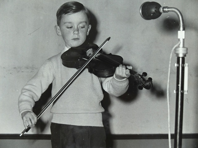 An 8 year-old Seamus McGuire performing at a Gael-Linn concert in Tullamore, Co Offally