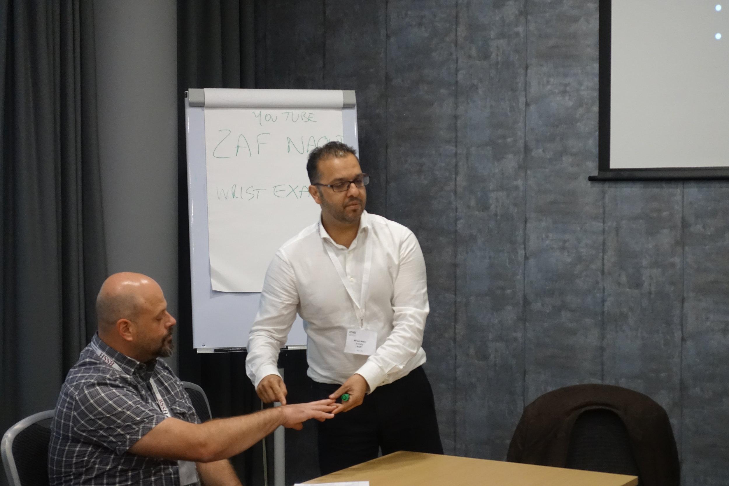 Mr Naqui teaching wrist examination