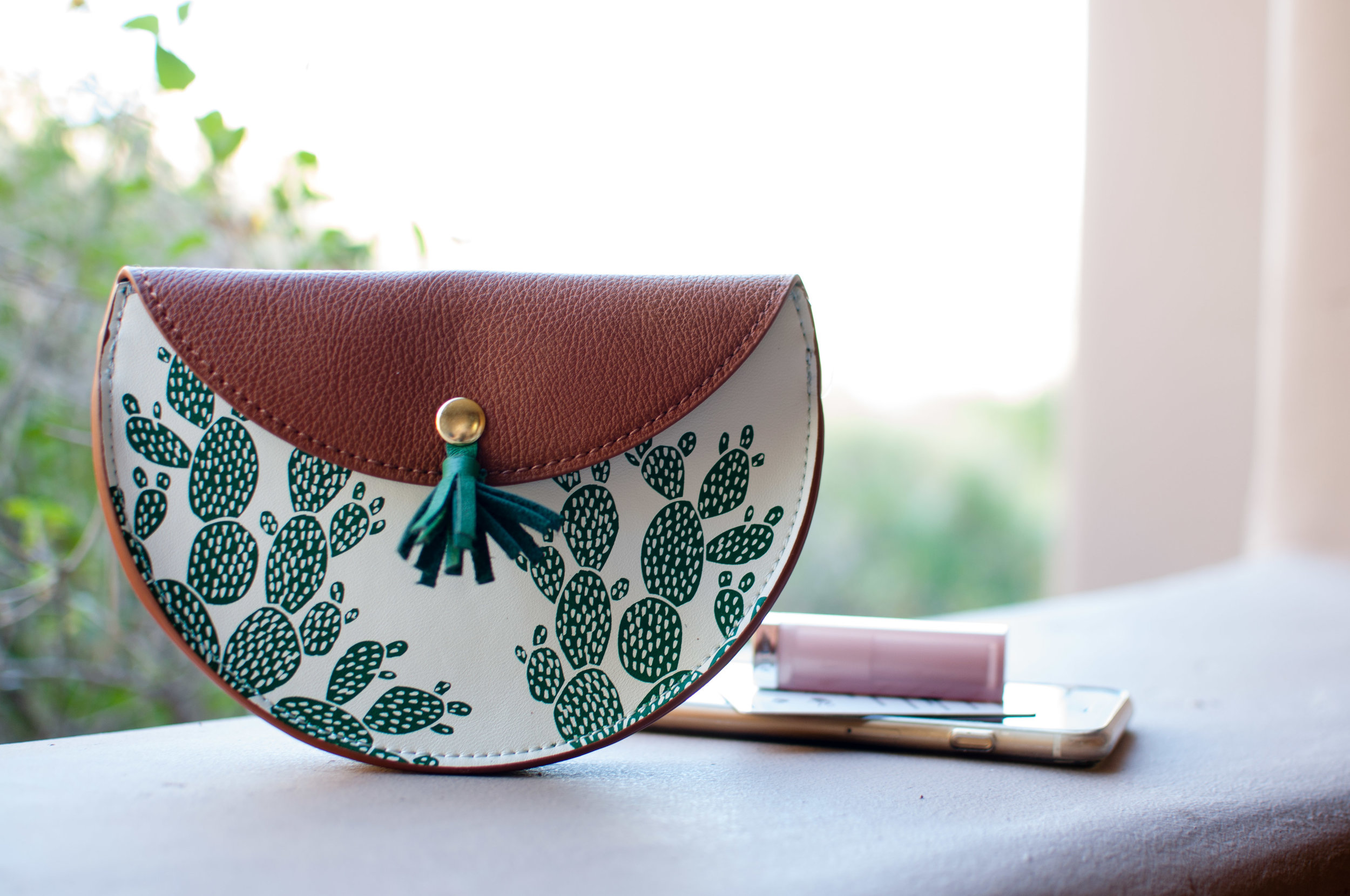 I walked into Anthropologie the other day without any intention of buying anything (but when does that work out in that store). I saw this cute  cactus pouch  and knew it would be the best accessory for carrying around my phone and keycard around the resort in Scottsdale, AZ.