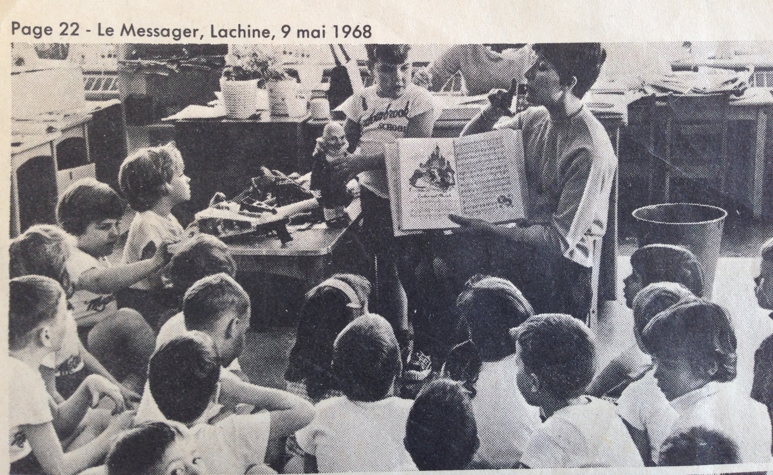 Mrs. Drummond reading a staged story for the benefit of the press, during show and tell.  That's me on the left, getting a closer look at Ricky's weird wizard doll that he brought in.  My toys were mostly cut outs of Bible characters stuck onto a flannel cloth, so seeing a somewhat pagan action figure was pretty exciting .
