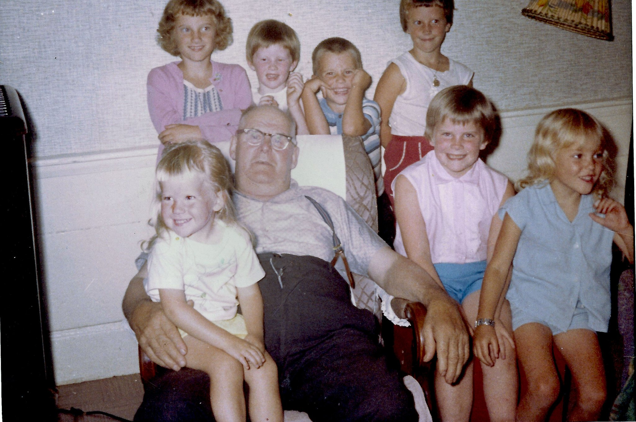 Just a few of my cousins, with yours truly on Grampy's lap. At any given time, there were hordes of us running around in and around the house. The only time we stopped was to eat.  I'm not sure hands got washed first though.