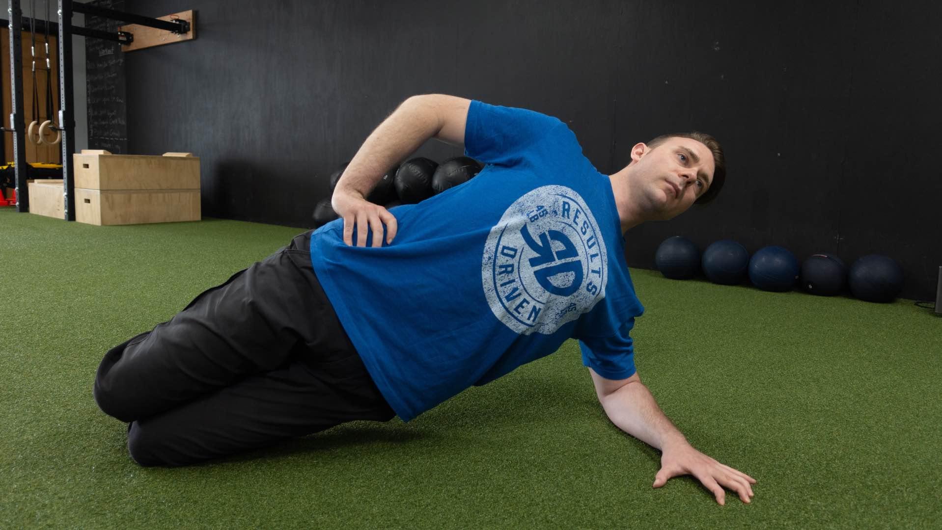 Coach Mike Side Plank 16x9_Fotor.jpg