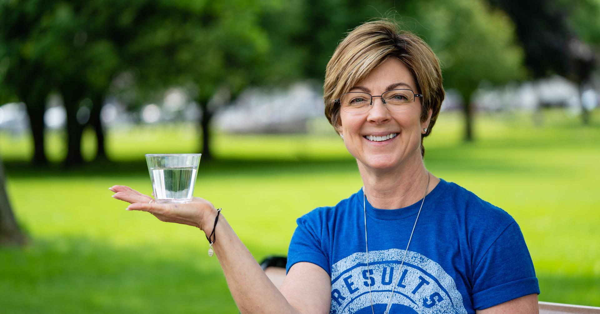 blog - cover photo - nutrition - nutrition level 1 - theresa holding cup of water facebook ad.jpg