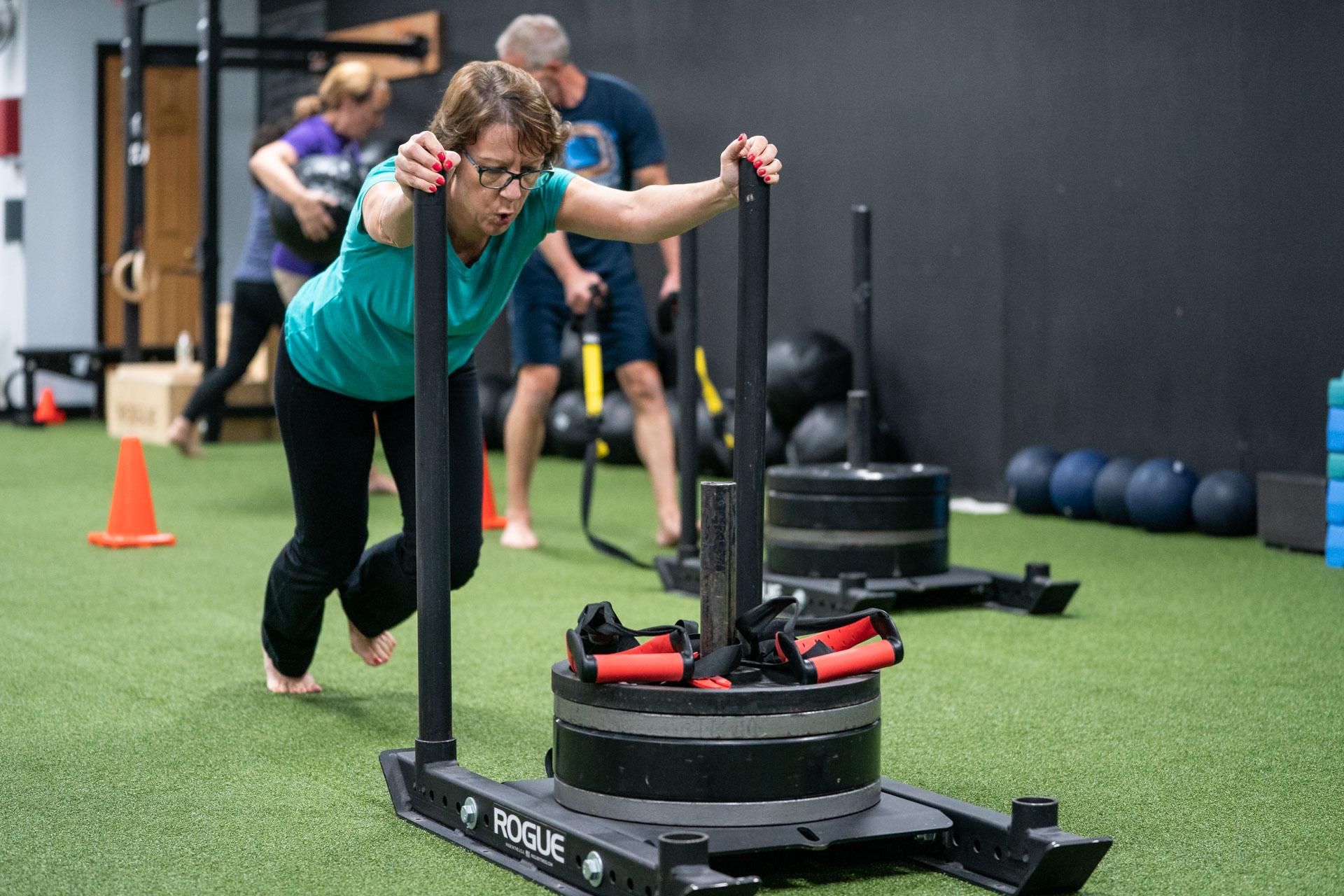 lead magnet - 5 fitness myths - nancy sled push 3x2.jpg