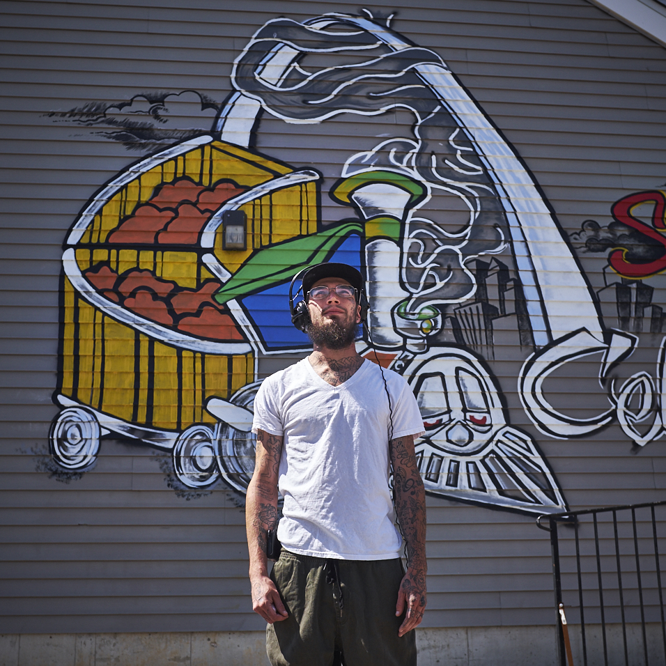 Painter Dustin Gravitt paints the outside of the Korner Konnection STL/Choo Choo Smoke Shop at 442 Bates St. Louis MO 63111 on Saturday April 8th, 2017.