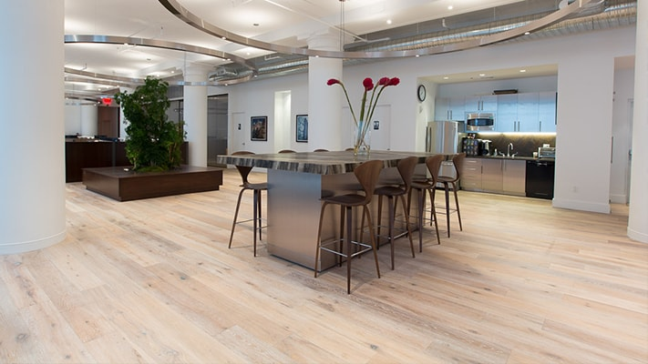 Always timeless, Artisanal Hardwoods is a curated selection of white oak and walnut in light to dark shades that make iconic hardwood planks look fresh yet maintain a rustic richness. This luxuriously crafted engineered hardwood collection with micro bevel edges is in stock and sustainable for any impactful design.