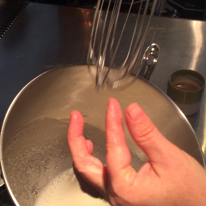 Use fingers to feel for sugar granules.  When you feel none it is ready to beat.