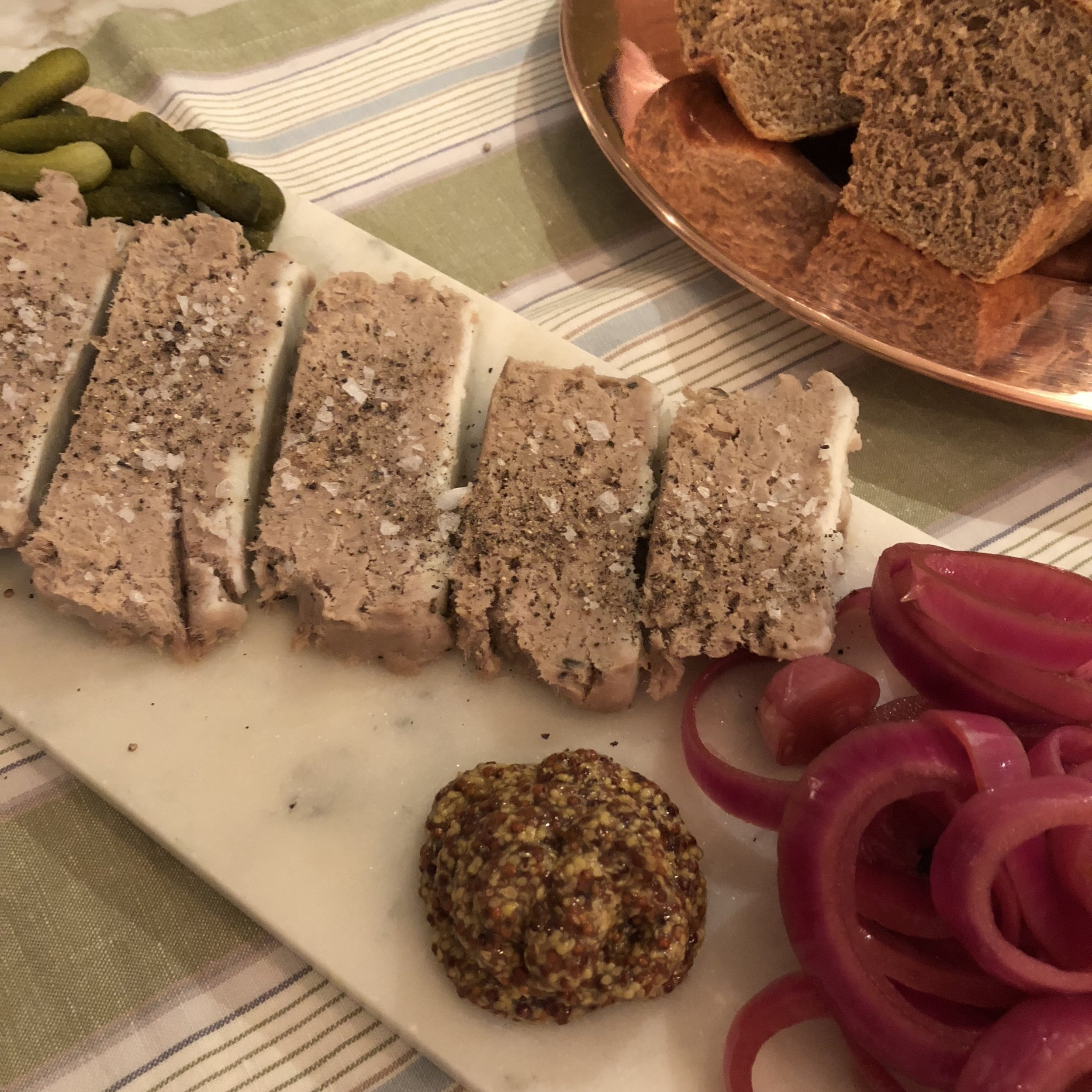 Serve with bread, mustard, pickled onions and cornichons.