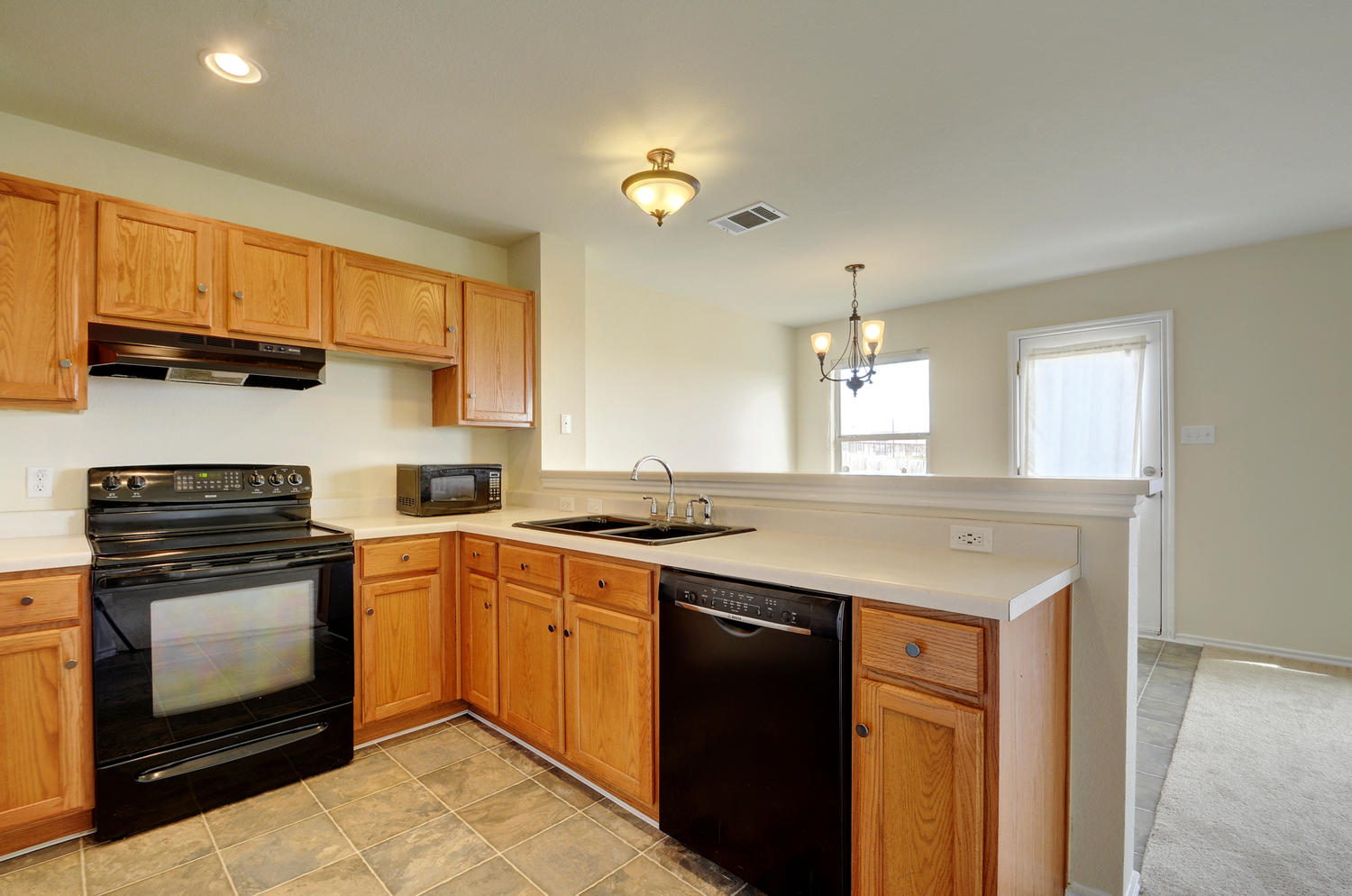 18409 Maxa Dr-large-013-9-Kitchen and Breakfast 013-1500x994-72dpi.jpg