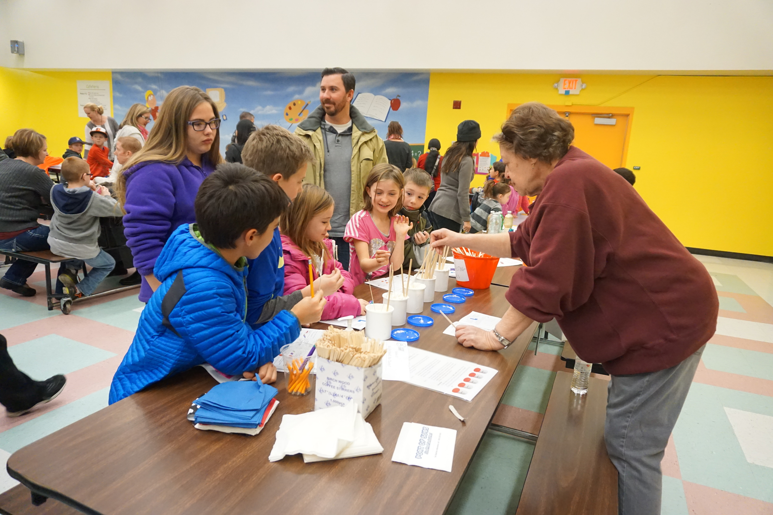 Marlys Pryor volunteers at a Family Science Night at Caughlin Ranch Elementary School.