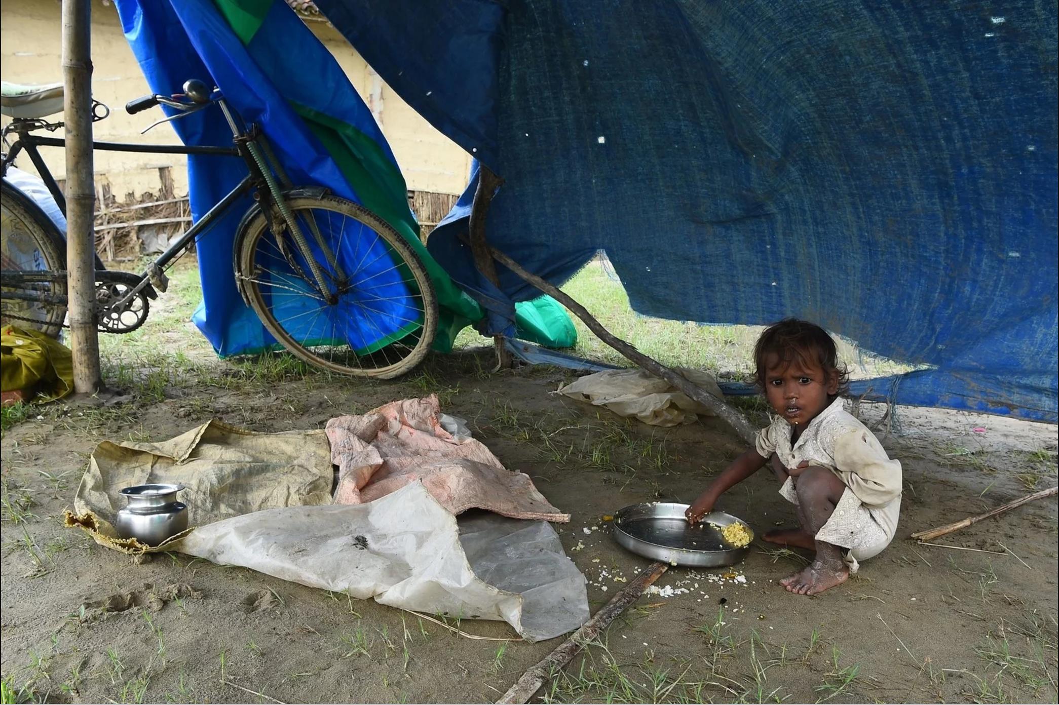 A child eats at a makeshift flood shelter in Gaur, about 200 km south of Kathmandu, the Nepali capital.Prakash Mathema / AFP / Getty Images