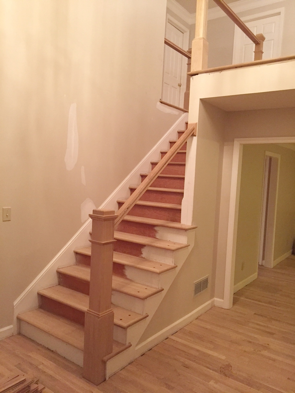 The old newel post was just too small for this tall and long entryway. By increasing the scale and replacing the treads with beautiful hardwoods, the staircase becomes a focal point not just a means of transportation.