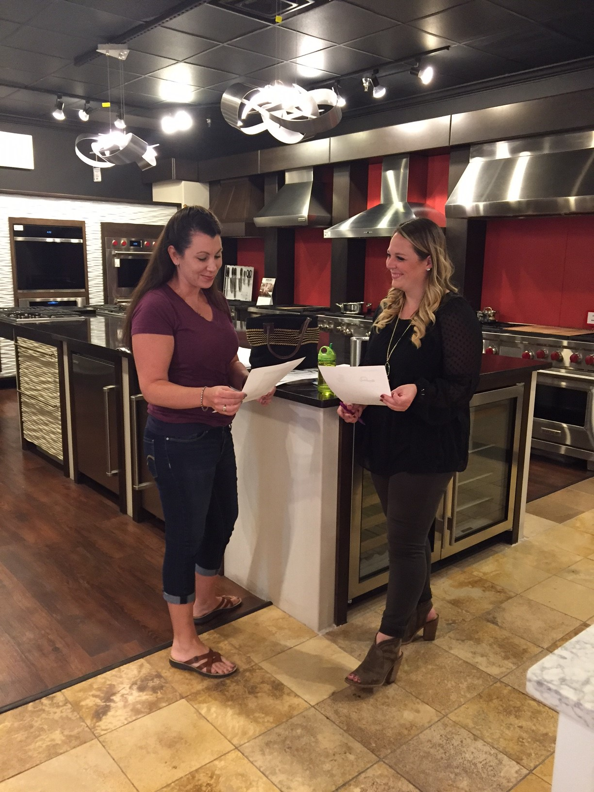 Stephanie & Madeline discussing appliance selections