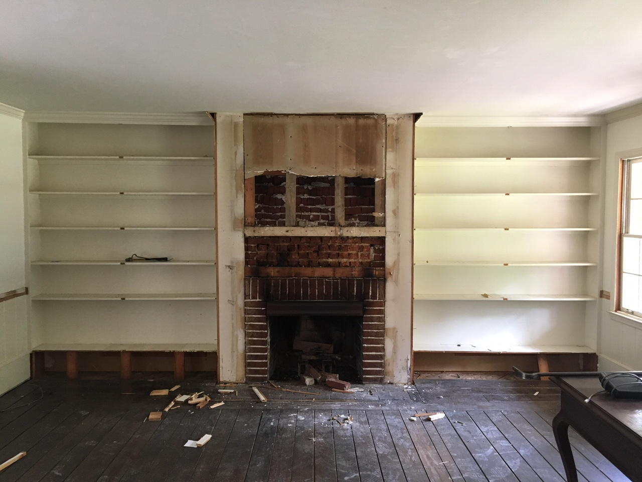 Smith project - demolition of the built ins & fireplace surround.